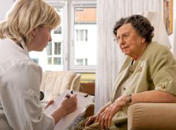 caregiver assisting patient in speaking